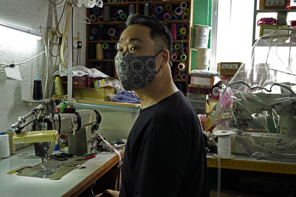 Edmond Kok, a Hong Kong theater costume designer and actor, wearing a face mask at his studio in Hong Kong Thursday, Aug. 6, 2020. With little theater...