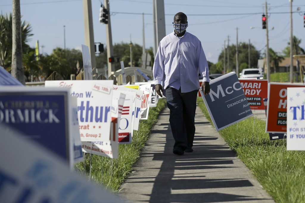 William Freeman, 51, walks outside of his polling station, Monday, Aug. 10, 2020, in Riviera Beach, Fla. Freeman recently registered to vote after ser...