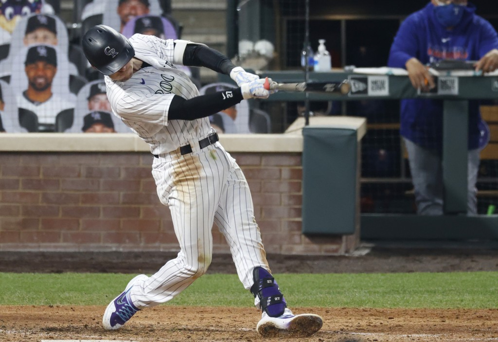 Colorado Rockies' Trevor Story connects for a double off Texas Rangers starting pitcher Kyle Gibson in the fifth inning of a baseball game Saturday, A...