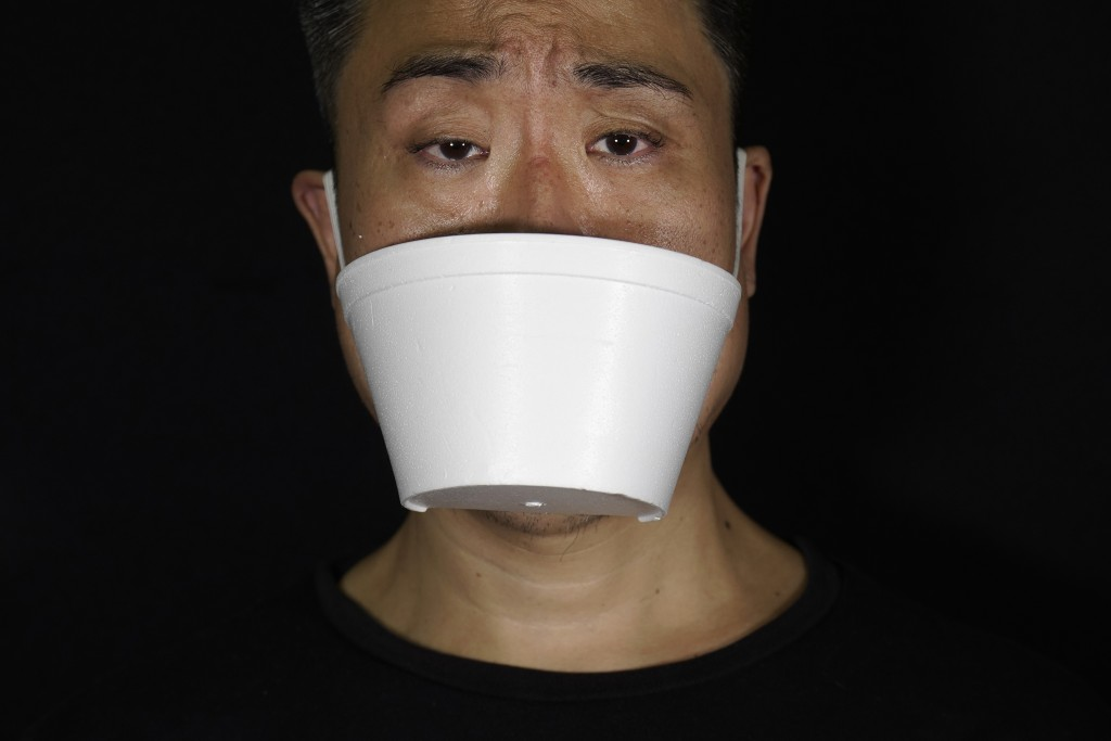 Edmond Kok, a Hong Kong theater costume designer and actor, wearing a face mask made from takeawaycontainer in Hong Kong Thursday, Aug. 6, 2020. With...