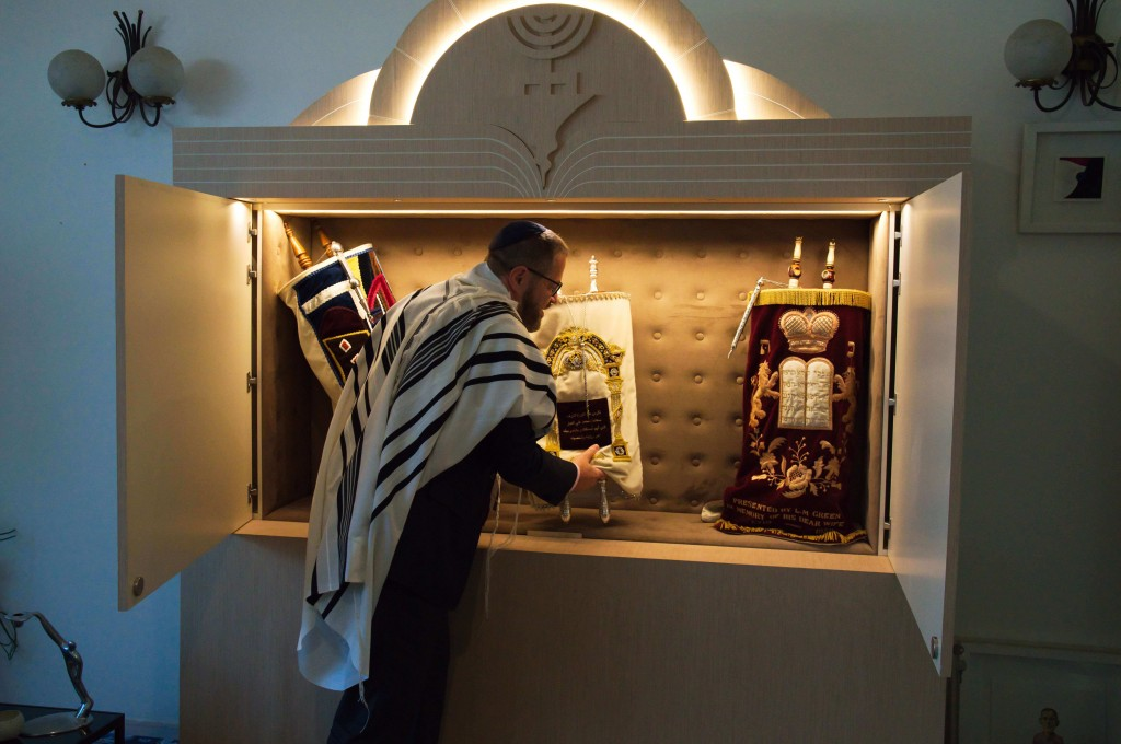 Alex Peterfreund, a co-founder of Dubai's Jewish community and its cantor, prepares to read from the Torah in Dubai, United Arab Emirates, Sunday, Aug...