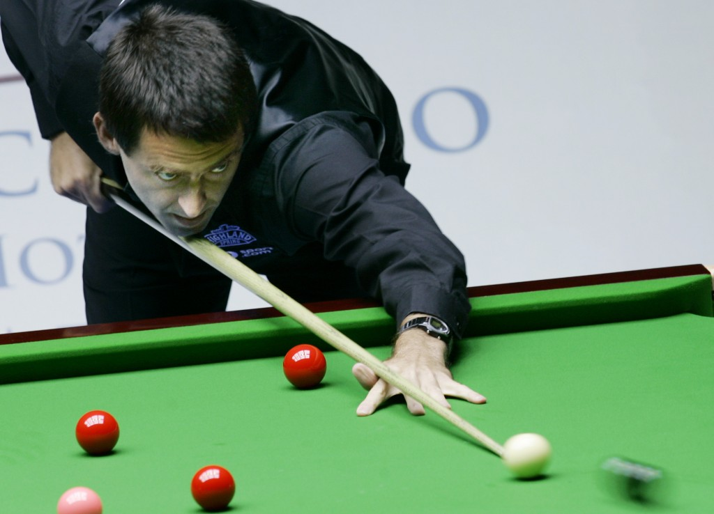 FILE - In this Thursday, July 12, 2007 file photo Ronnie O'Sullivan of England aims a shot during an invitation match against Supoj Saenla of Thailand...