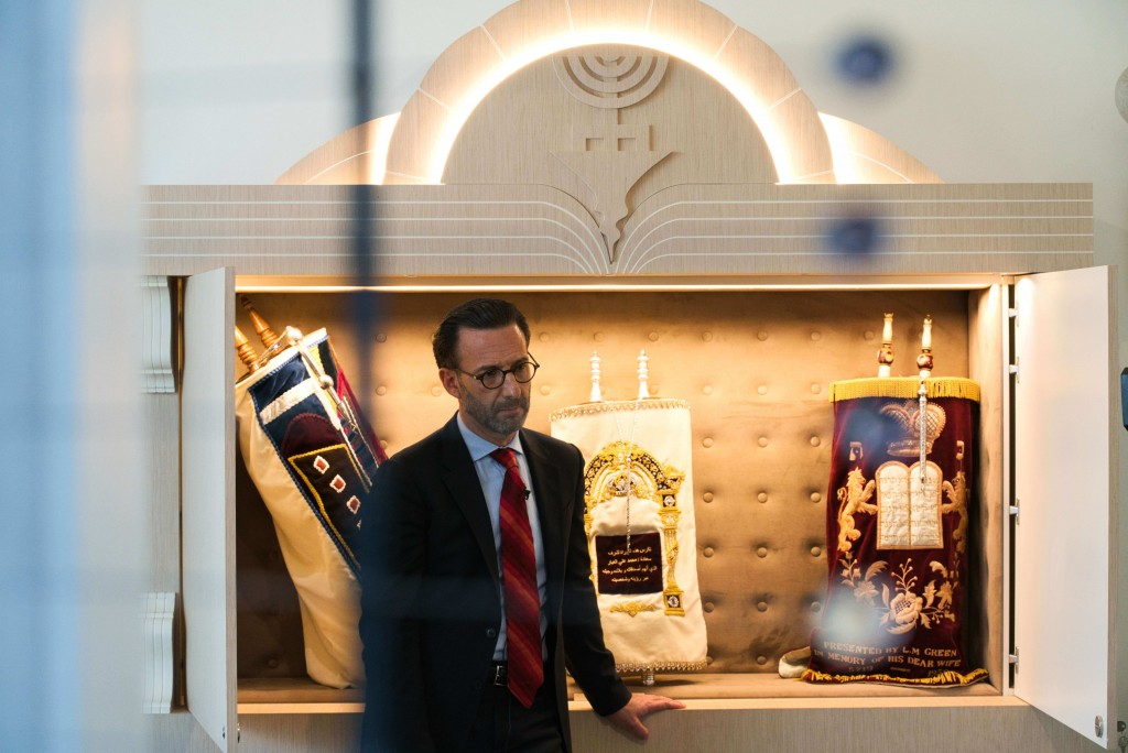 Ross Kriel, the president of the Jewish Council of the Emirates, speaks to The Associated Press in front of the community's Torahs in Dubai, United Ar...