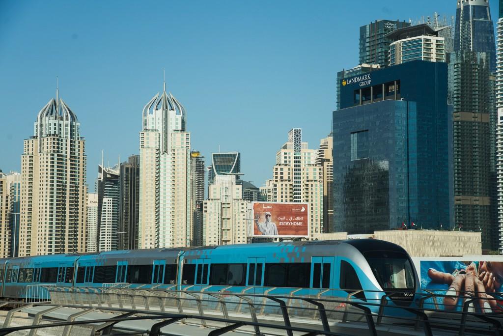 FILE - In this April 26, 2020 file photo, the driverless Metro passes the Dubai Marina  in Dubai, United Arab Emirate. For eager Israelis, anticipatio...