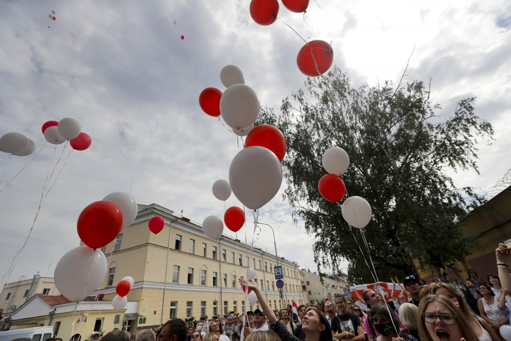 """People shout a slogan """"release (from prison)"""" to show their solidarity with the detainees and people release balloons in colors of old Belarusian nati..."""
