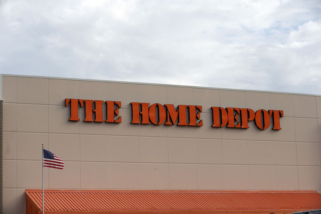FILE - In this Aug. 27, 2019 file photo, the Home Depot logo is shown on a store in Bloomington, Minn. Home Depot's fiscal second-quarter sales surged...