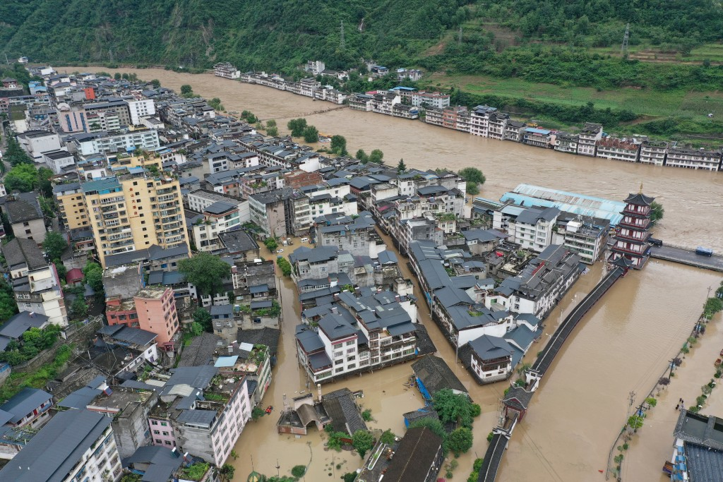 In this aerial photo released by China's Xinhua News Agency, flooding is seen in Bikou township of Longnan city in northwestern China's Gansu Province...
