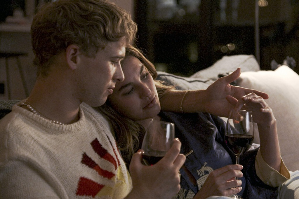"""This image released by Freeform shows Tommy Dorfman, left, and Rainey Qualley in a scene from """"Love in the Time of Corona,"""" a two-part series airing A..."""