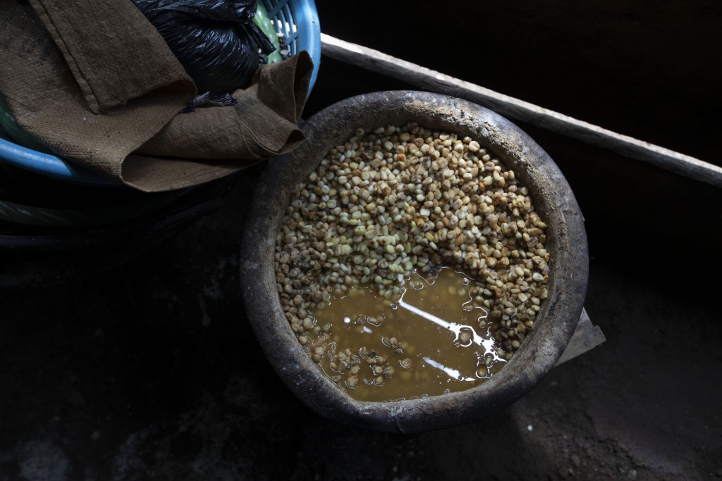 Corn left uncooked sits in a home's kitchen where its inhabitants left it behind due to an attack by unidentified, armed men, on a coffee plantation i...