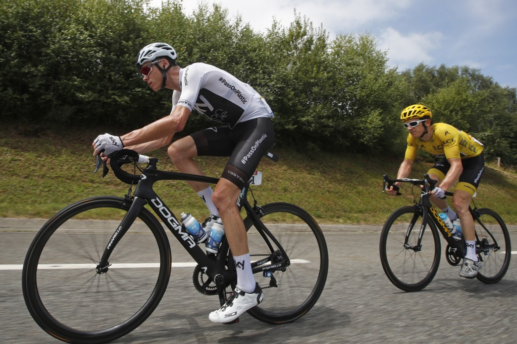 FILE - In this July 27, 2018 file photo, Britain's Chris Froome, left, and Britain's Geraint Thomas, wearing the overall leader's yellow jersey, climb...