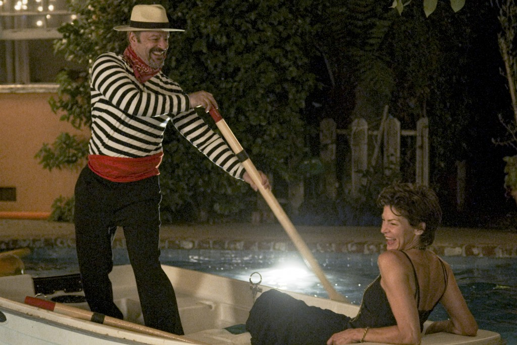 """This image released by Freeform shows Gil Bellows, left, and Rya Kihlstedt in a scene from """"Love in the Time of Corona,"""" a two-part series airing Aug...."""
