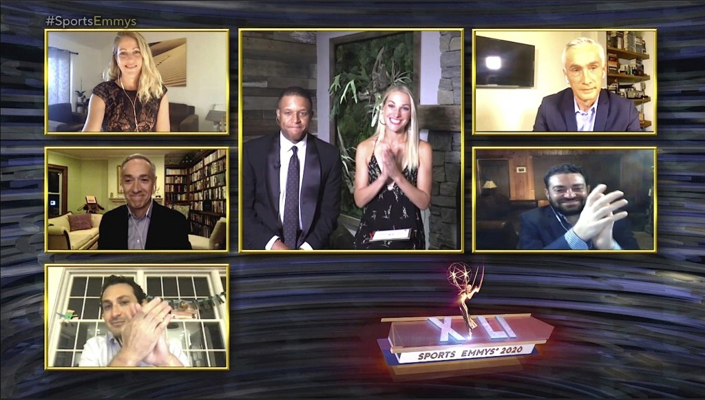 This image released by National Academy of Television Arts & Sciences (NATAS) shows presenters Craig Melvin and Lindsay Czarniak, center, and nominees...