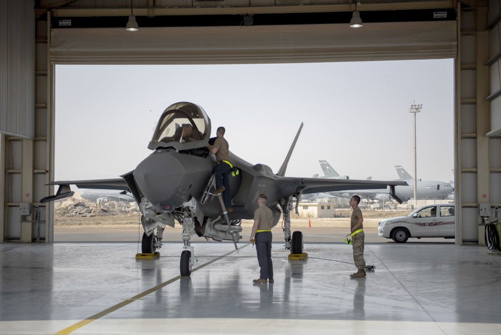 In this Aug. 5, 2019, photo released by the U.S. Air Force, an F-35 fighter jet pilot and crew prepare for a mission at Al-Dhafra Air Base in the Unit...