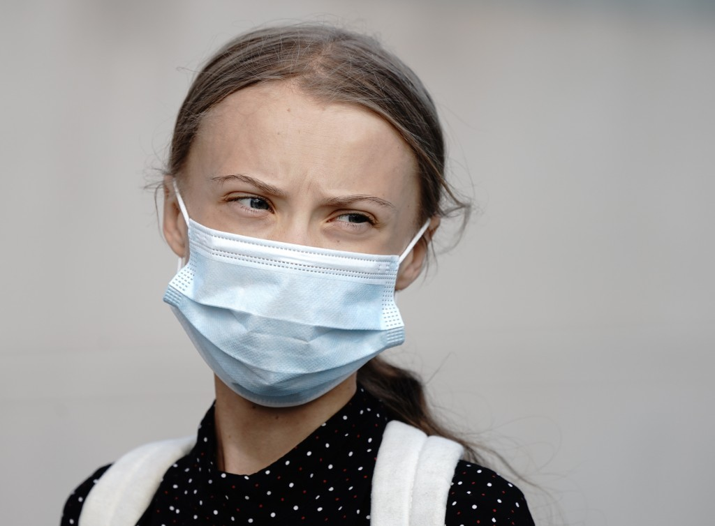 Climate activists Greta Thunberg wears a face mask as she arrives for a meeting with German Chancellor Angela Merkel at the chancellery in Berlin, Ger...