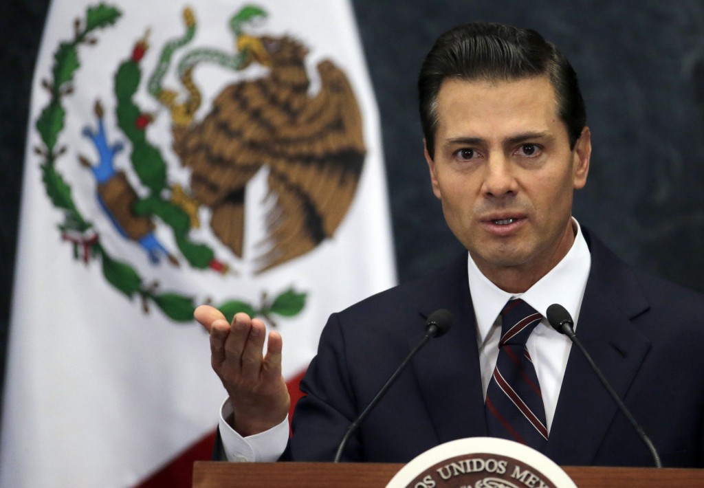 FILE - In this Wednesday, Jan. 4, 2017, file photo, then-Mexico's President Enrique Pena Nieto speaks during a news conference at the Los Pinos presid...