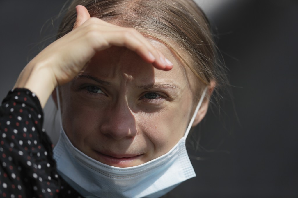 Climate activist Greta Thunberg attends a news conference following a meeting with German Chancellor Angela Merkel in Berlin, Germany, Thursday, Aug. ...