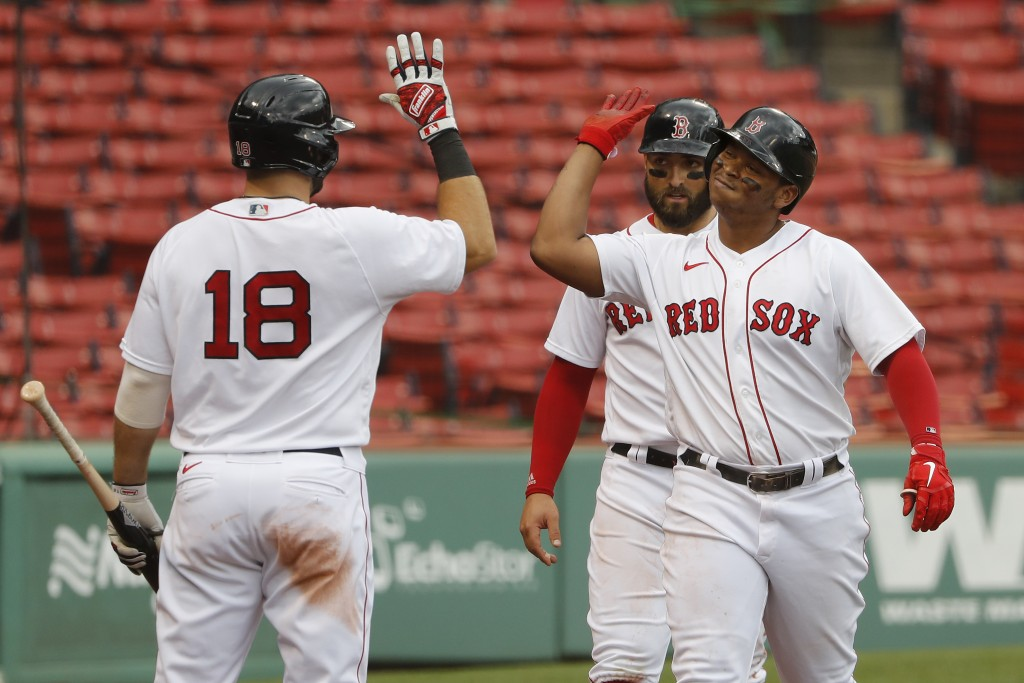 Boston Red Sox's Rafael Devers is congratulated by Mitch Moreland (18) after his two-run home run against the Philadelphia Phillies during the third i...