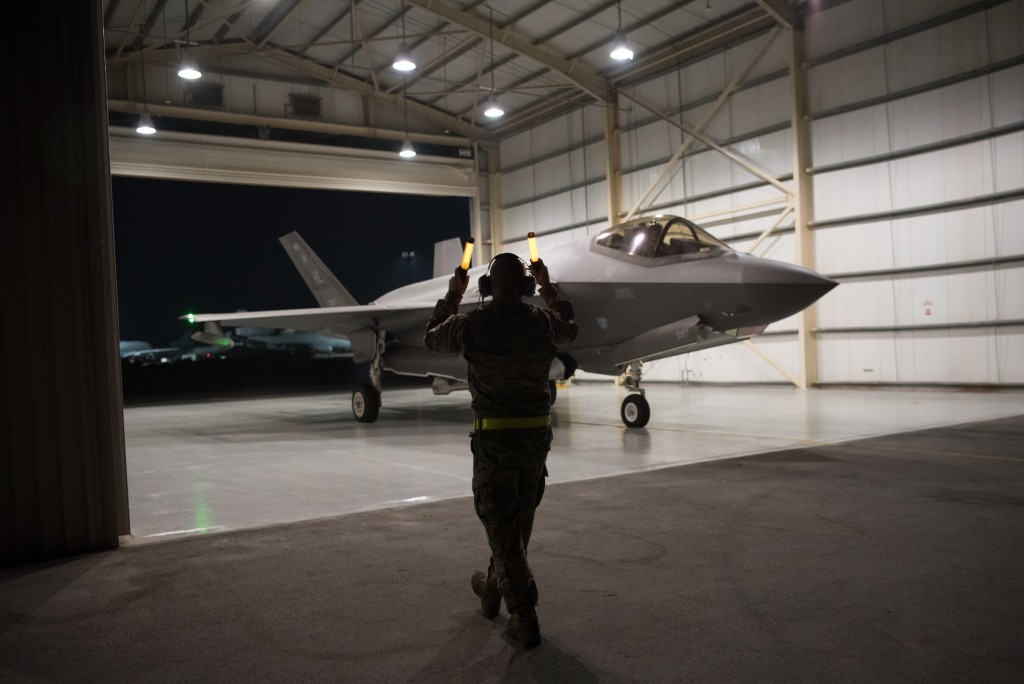 In this Sept. 10, 2019, photo released by the U.S. Air Force, an F-35A Lightning II fighter jet is directed out of a hangar at Al-Dhafra Air Base in t...