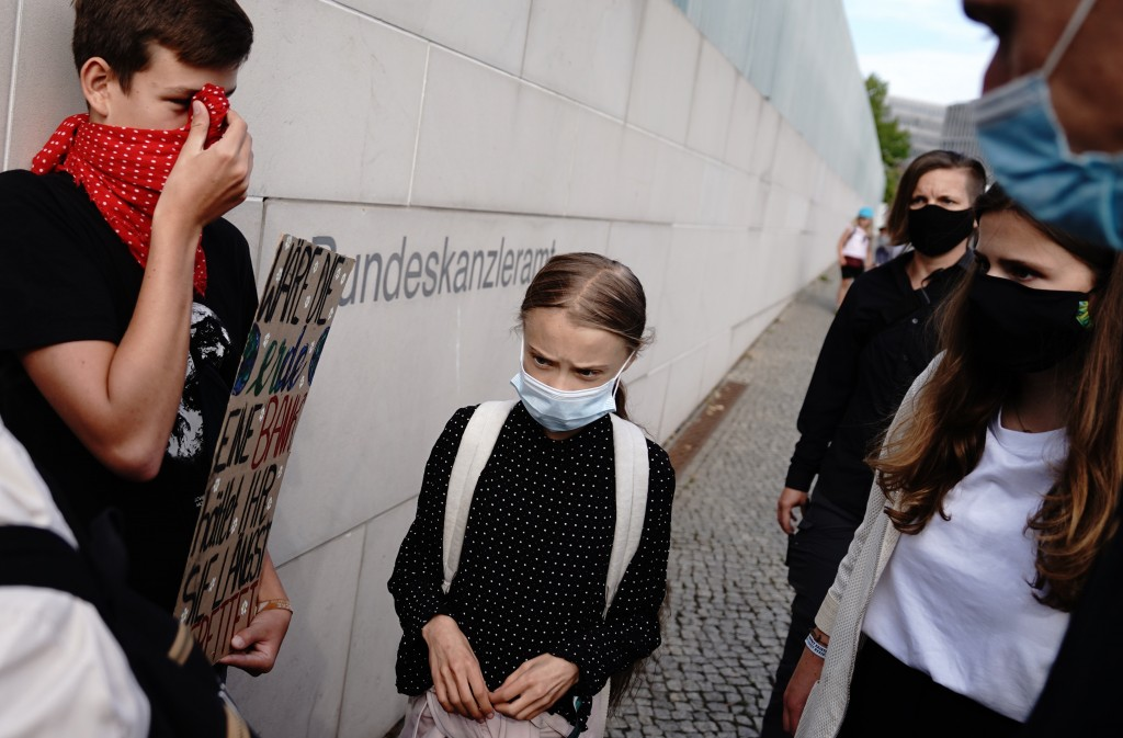 Climate activists Greta Thunberg, center, arrives for a meeting with German Chancellor Angela Merkel at the chancellery in Berlin, Germany, Thursday, ...
