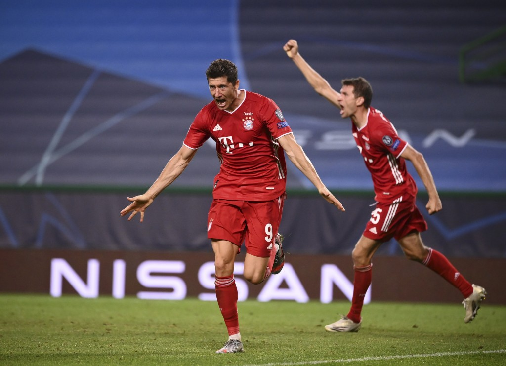 Bayern's Robert Lewandowski celebrates after scoring his side's third goal during the Champions League semifinal soccer match between Lyon and Bayern ...