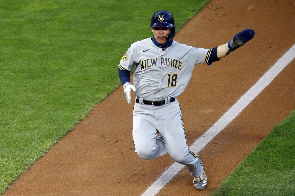 Milwaukee Brewers' Keston Hiura begins his slide into home on an RBI double by Avisail Garcia in the third inning of a baseball game Wednesday, Aug. 1...