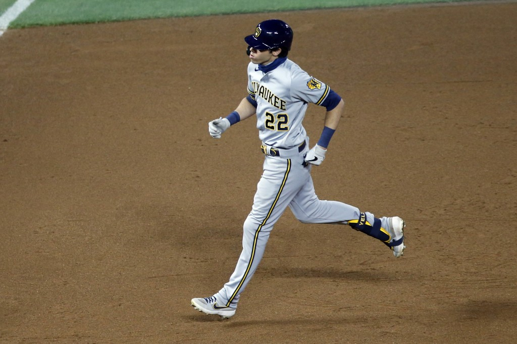 Milwaukee Brewers' Christian Yelich rounds the bases on his two-run home run off Minnesota Twins relief pitcher Lewis Thorpe in the fifth inning of a ...