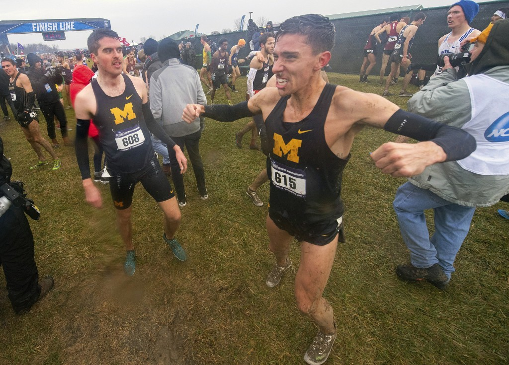 FILE - In this Nov. 23, 2019, file photo, Michigan junior Devin Meyrer (615), right, reacts with teammate Jack Aho (608) after finishing the men's NCA...