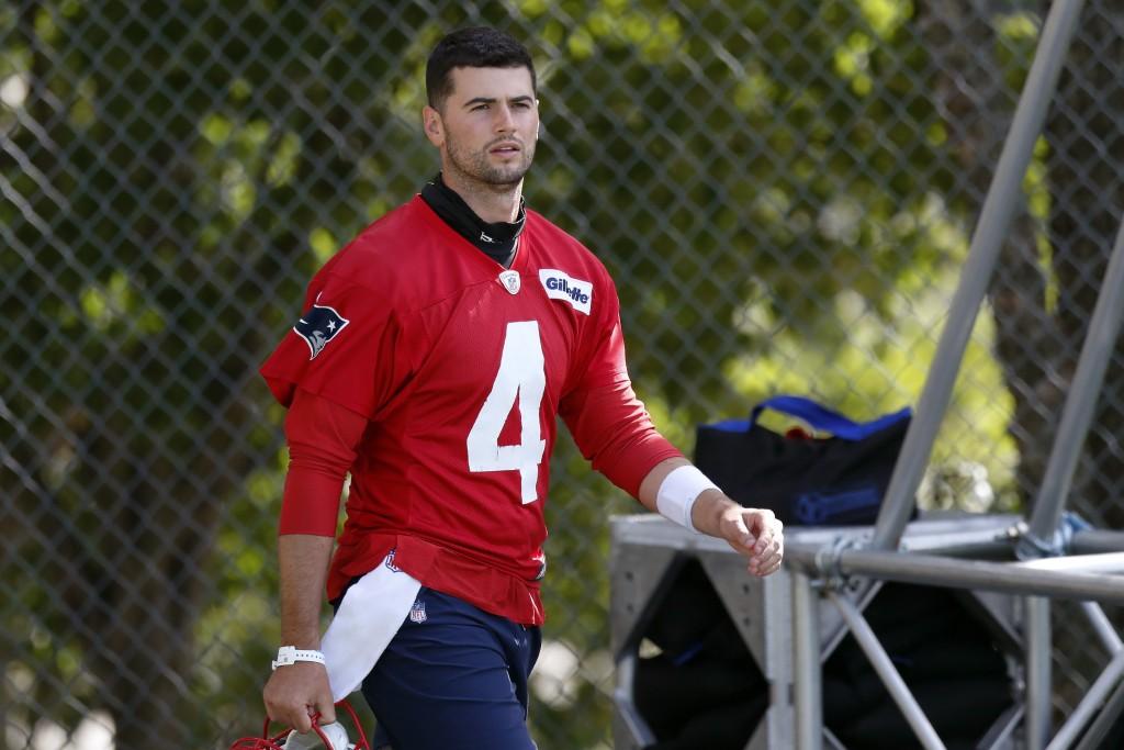 New England Patriots quarterback Jarrett Stidham walks to the field for an NFL football training camp practice, Friday, Aug. 21, 2020, in Foxborough, ...