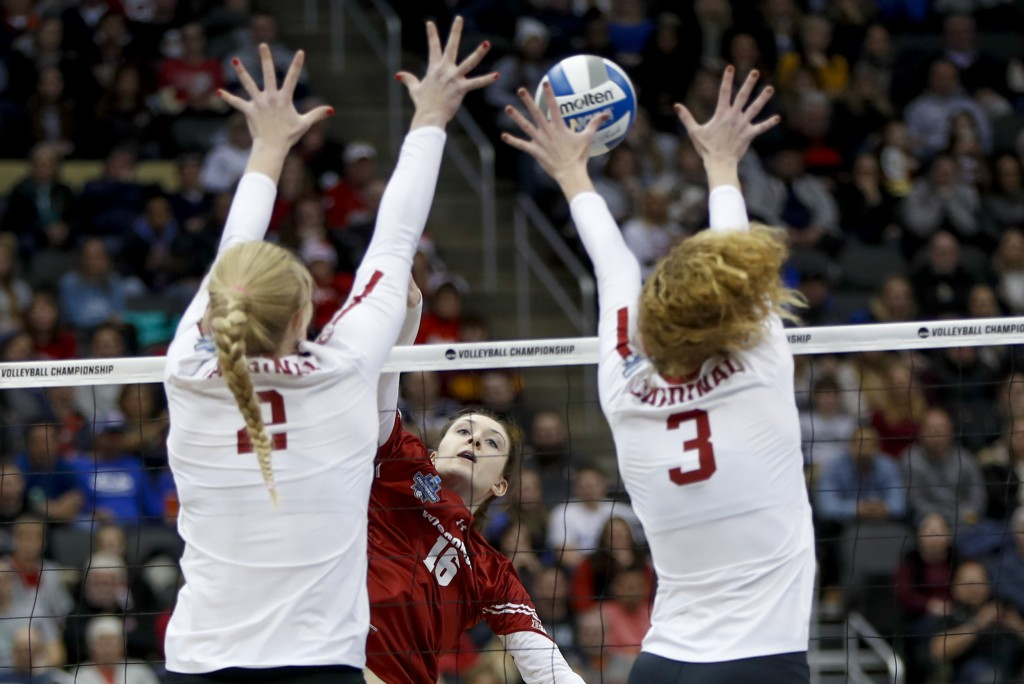 FILE - In this Dec. 21, 2019, file photo, Wisconsin's Dana Rettke (16) has a spike blocked by Stanford's Holly Campbell (3) and Kate Formico (11) duri...