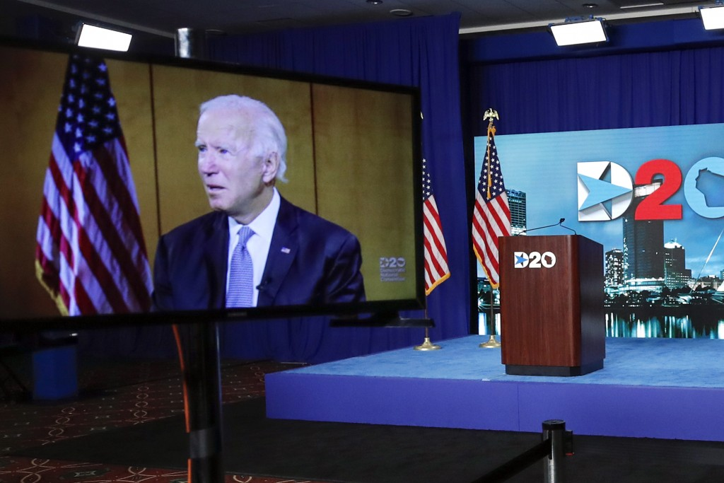 Images of Democratic presidential candidate former Vice President Joe Biden are shown on a screen during the final night of the virtual 2020 Democrati...