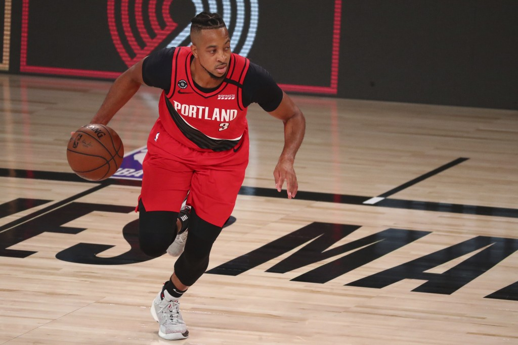 Portland Trail Blazers guard CJ McCollum (3) brings the ball upcourt against the Los Angeles Lakers during the first half in Game 2 of an NBA basketba...