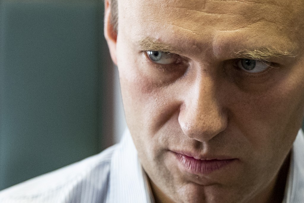 FILE - In this Wednesday, Sept. 5, 2018 file photo Russian opposition leader Alexei Navalny stands during a break in the hearing on his appeal in a co...