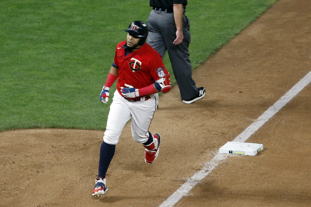Minnesota Twins designated hitter Nelson Cruz rounds third base after hitting a two-run home run off Milwaukee Brewers' pitcher Freddy Peralta in the ...