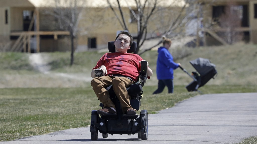 FILE - In this April 14, 2020, file photo, Jacob Hansen rides near his house on in Eagle Mountain, Utah. Utah overhauled crisis guidelines Thursday, A...
