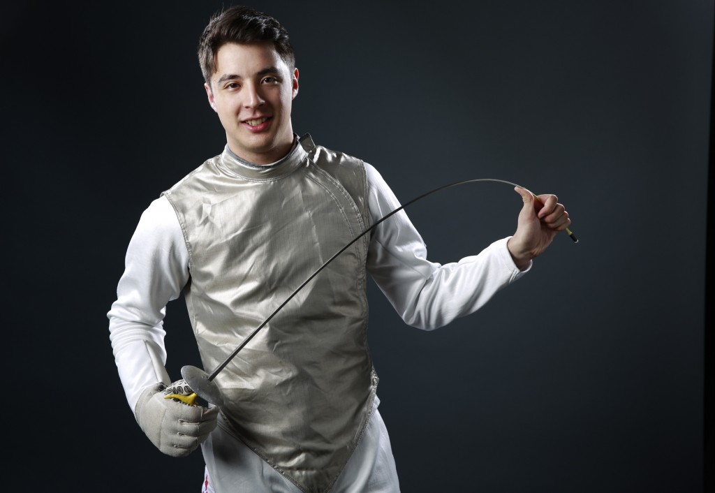 FILE - In this March 9, 2016, file photo, Olympic fencer Alex Massialas poses at the 2016 Team USA Media Summit in Beverly Hills, Calif. If all the at...