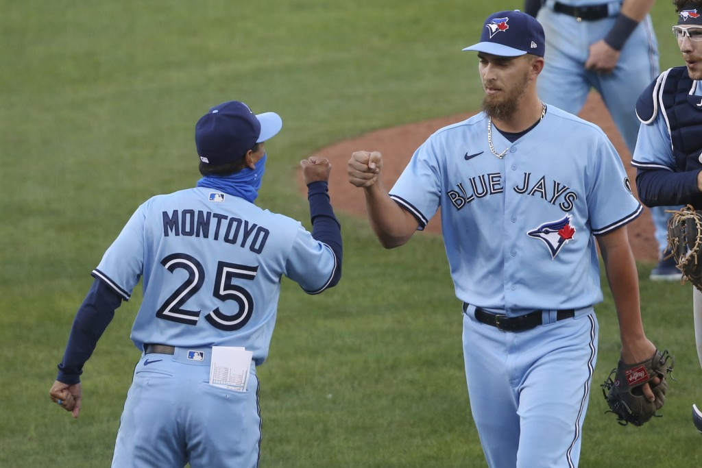 Toronto Blue Jays closing pitcher A.J. Cole and manager Charlie Montoyo celebrate a win over the Philadelphia Phillies following the second game of a ...