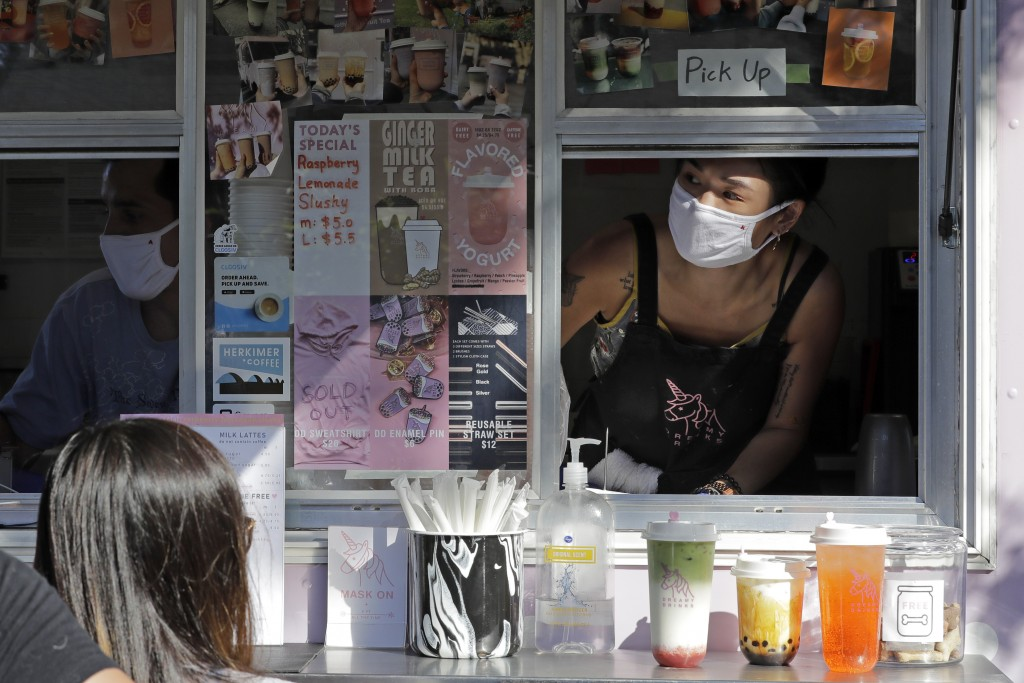 Kaye Fan, right, calls out orders as she works in her Dreamy Drinks food truck, Monday, Aug. 10, 2020, near the suburb of Lynnwood, Wash., north of Se...