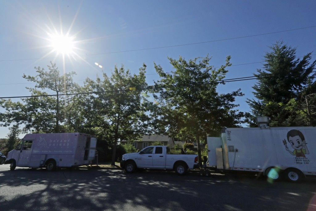 The Dreamy Drinks and YS Street Food food trucks sit parked, Monday, Aug. 10, 2020, near the suburb of Lynnwood, Wash., north of Seattle. Long seen as...