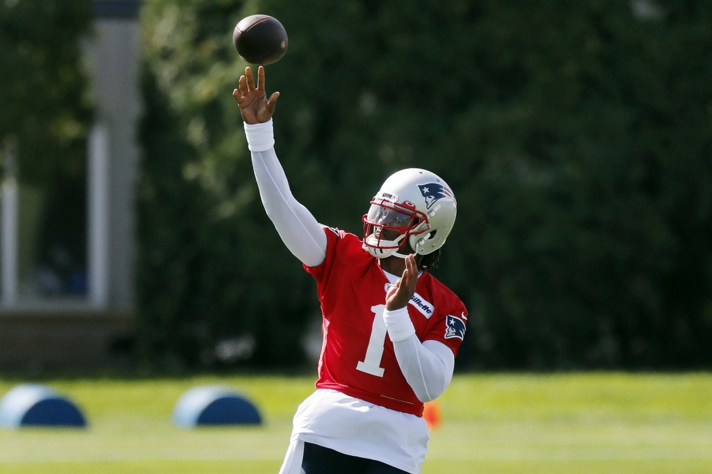 New England Patriots quarterback Cam Newton (1) passes during an NFL football training camp practice, Friday, Aug. 21, 2020, in Foxborough, Mass. (AP ...