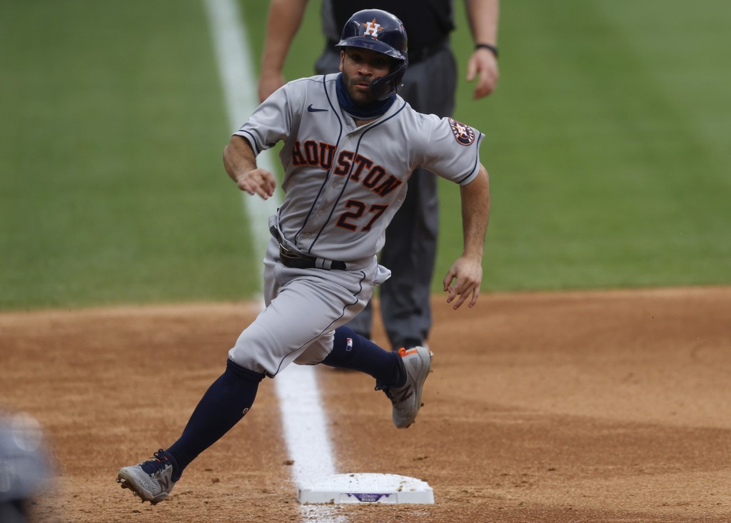 Houston Astros' Jose Altuve rounds third bse to score on a single hit by Yuli Gurriel off Colorado Rockies starting pitcher German Marquez in the fift...