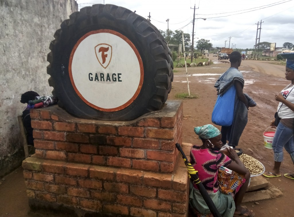 A tyre is used to mark the entrance to Firestone's garage in the town of Harbel, Liberia Saturday, July 18, 2020. The rubber industry in Liberia has g...