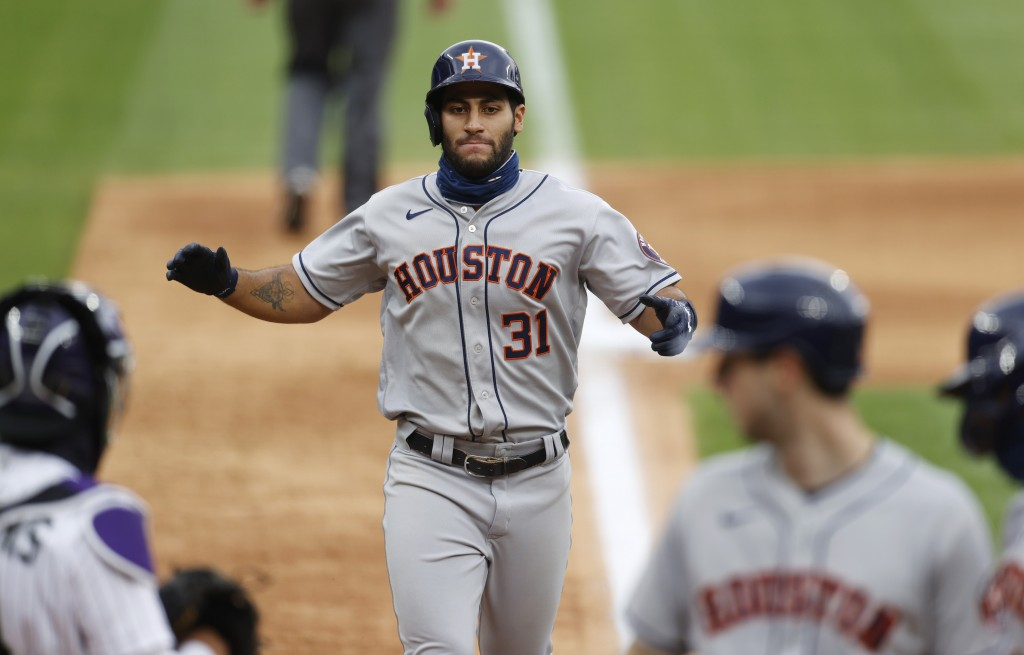 Houston Astros' Abraham Toro celebrates as he crosses home plate after hitting a three-run home run off Colorado Rockies starting pitcher German Marqu...