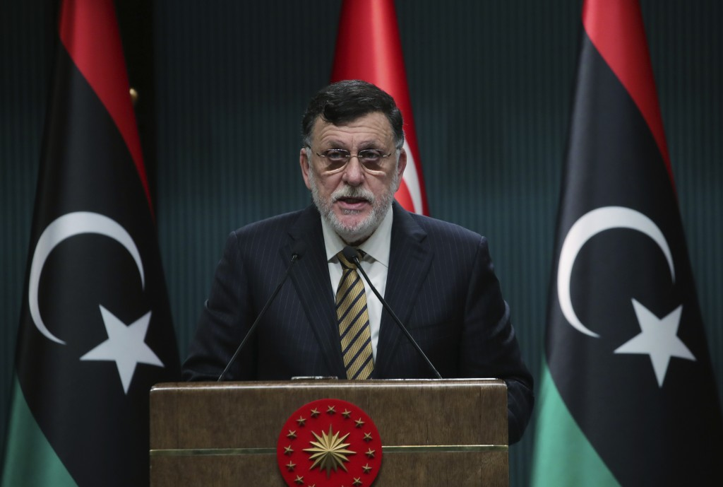 FILE - In this June 4, 2020 file photo, Fayez Sarraj, the head of Libya's internationally-recognized government, speaks at a joint news conference wit...