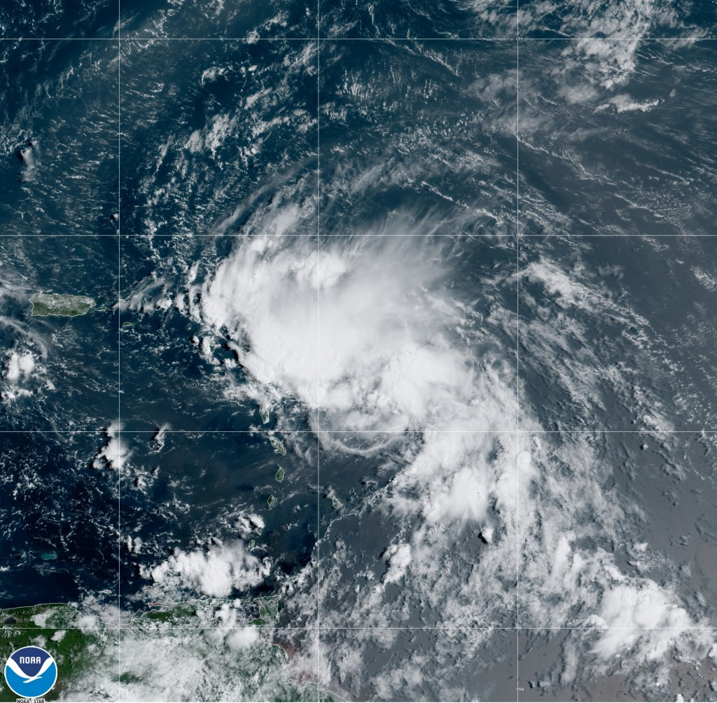 This satellite image released by the National Oceanic and Atmospheric Administration (NOAA) shows Tropical Storm Laura in the North Atlantic Ocean, Fr...