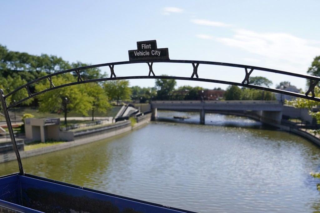 A view of the Flint River in downtown Flint, Mich, Thursday, Aug. 20, 2020. Michigan Gov. Gretchen Whitmer says a proposed $600 million deal between t...