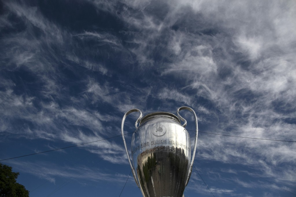 A giant replica of the UEFA Champions League trophy is displayed at the Rossio square downtown Lisbon, Portugal, Friday, Aug. 21, 2020. PSG will play ...