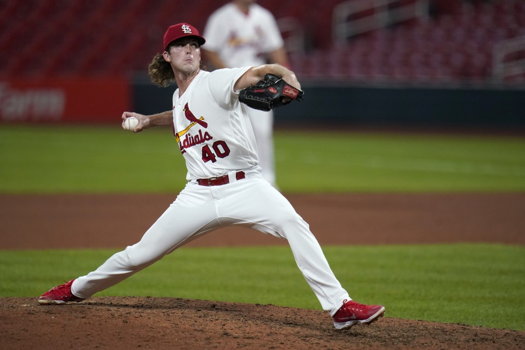 St. Louis Cardinals pitcher Jake Woodford throws during the ninth inning of a baseball game against the Cincinnati Reds Friday, Aug. 21, 2020, in St. ...