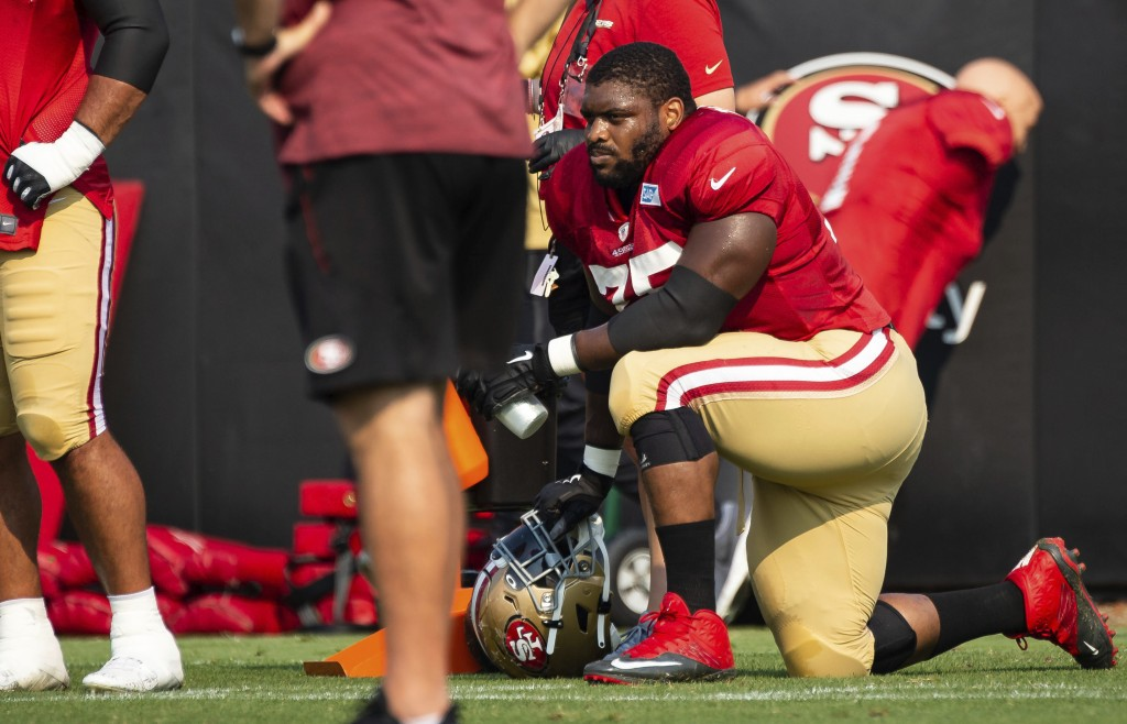 San Francisco 49ers guard Laken Tomlinson (75) takes a water break on the sidelines during NFL football training camp Friday, Aug. 21, 2020, in Santa ...