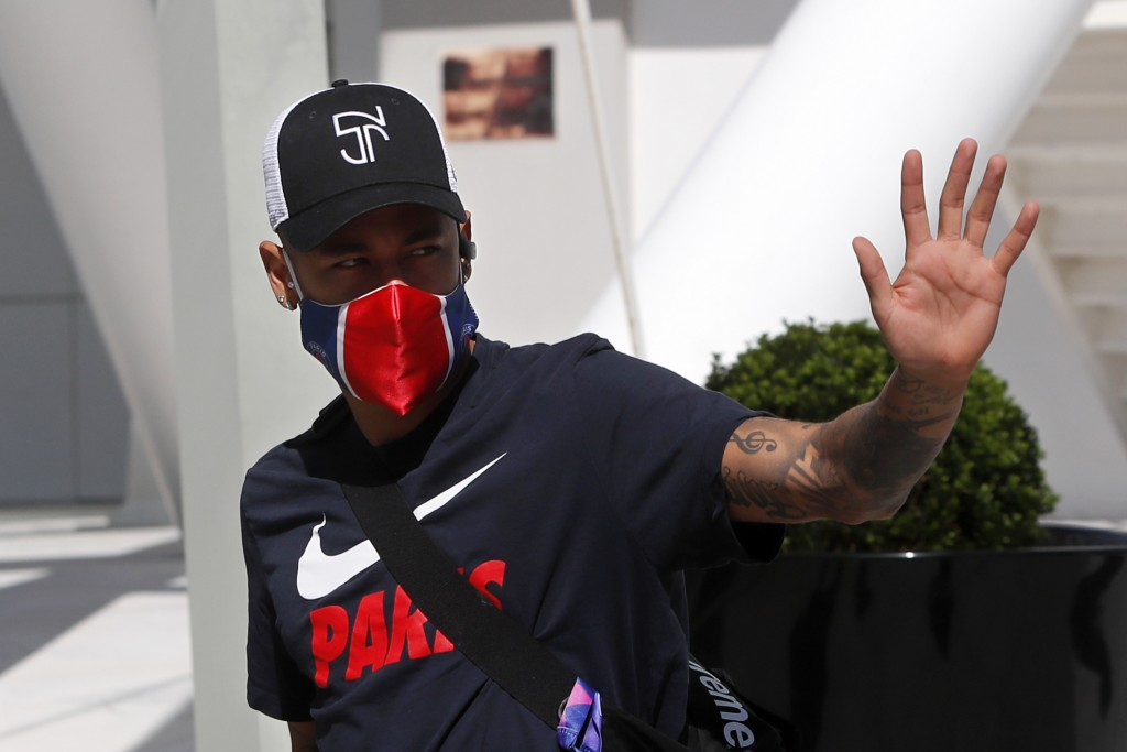 PSG's Neymar waves to fans as he leaves the team hotel for a training session in Lisbon, Friday Aug. 21, 2020. PSG will play Bayern in the Champions L...