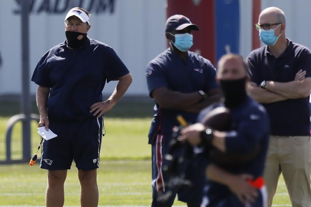New England Patriots head coach Bill Belichick, left, watches during an NFL football training camp practice, Friday, Aug. 21, 2020, in Foxborough, Mas...